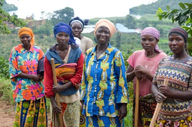 Cyimbili women preparing to help dig a drainage ditch along the side of the road for their village