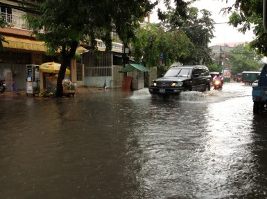 After an hour of heavy rain, the main streets of Phnom Penh look more like canals.