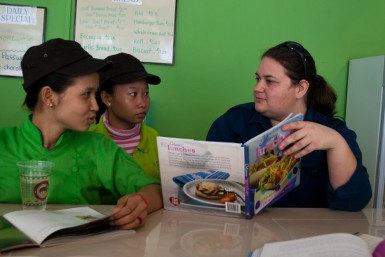 Ryana going over new recipes with students of the Culinary Training Center.