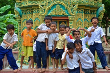 Kids have fun in the primary school yard and the Pagoda next door during a break between classes.