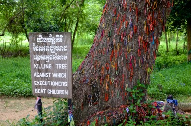 A tree Khmer Rouge executioners dashed babies against, now covered in bracelets to memorialize the dead.