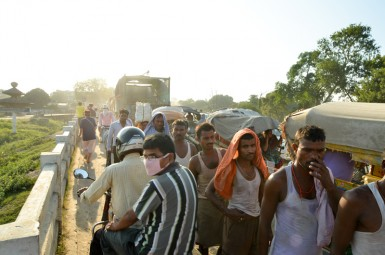 Nepali and Indians walk freely across the physical border between Nepal and India at the Birgunj border crossing