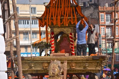 Men prepare the Kumari's golden chariot