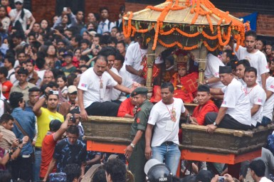 The Kumari being carried through the streets in her golden chariot