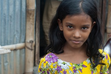 In the Duaripara Slum on the edge of Dhaka, poverty leads many families to make difficult choices. Girls, often seen as less valuable than boys, receive less education, less healthcare, and less attention then their male counterparts. Photo by Brad Miller