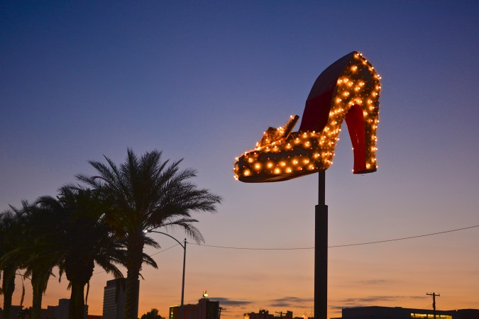 Boasting one of the most famous Las Vegas signs ever, the original building was built in 1950. In 1968, business magnate Howard Hughes bought the Silver Slipper because, as legend has it, the lights from the slipper bothered him at night. The fact that the tip of the shoe paused in his direction as it rotated led him to believe spies had placed a camera on it to watch him in the penthouse next door.