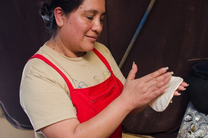 Traditional Guatemalan corn tortillas are not made with a tortilla press. Every single one is patted and turned by hand. The patting sounds made by this process can be heard outside of tortillarias (tortilla shops) all over town.