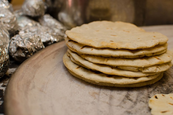 Each tortilla is cooked on both sides until golden brown. The imperfections of hand-pressing them give each a unique character and shape.