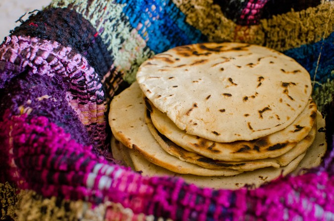 When the tortillas are done cooking, they are wrapped in a wool blanket, which keeps them moist and warm. Delicious.