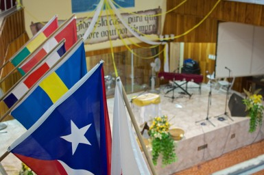 Flags representing partner nations of the church hang above the sanctuary.