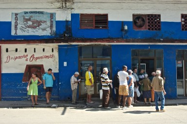A line of people standing outside a bakery for their daily ration of bread