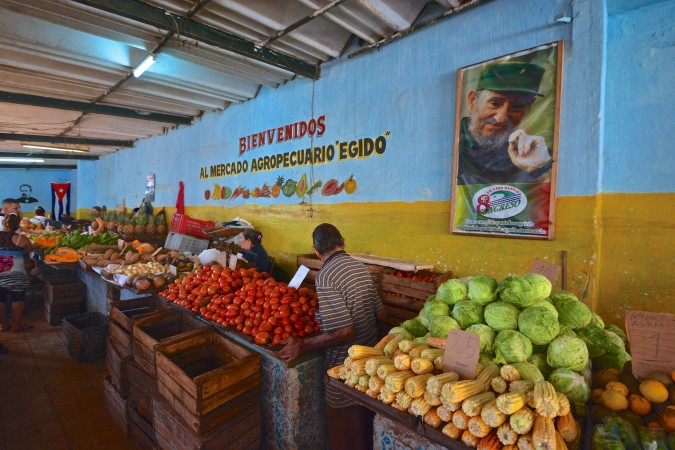Fidel Castro's image can be seen in all corners of the country. It is a constant reminder of the Revolution and what occurred 55 years ago. Here, Fidel's image overlooks a Havana market.
