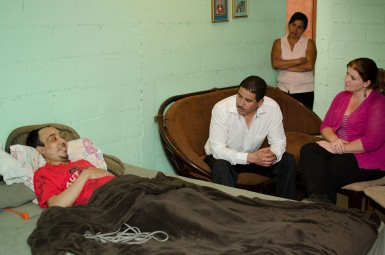 Cesar shares some encouragements with Rudi Pineda, the principal of Saber y Gracia, and Lauren Pupchik, a full-time missionary and teacher at the school, while Cesar's wife looks on from the doorway