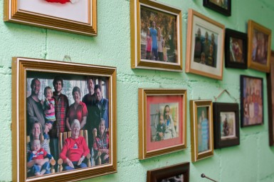 The wall opposite Cesar's bed is covered with the photos of friends who have visited him from all over the world.
