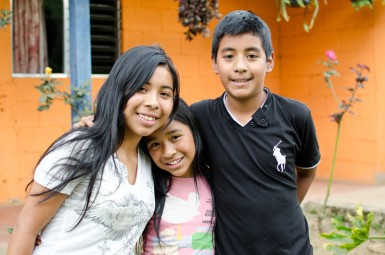 Cesar's children, Lisbeth, Josselyn, and Pablo, who are thriving as students in Saber y Gracia's sponsorship program