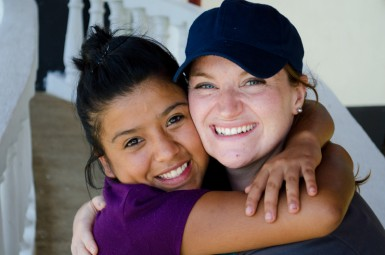 Lauren with Gisel, a SyG high school student, at Campamento, the school's annual high school retreat.