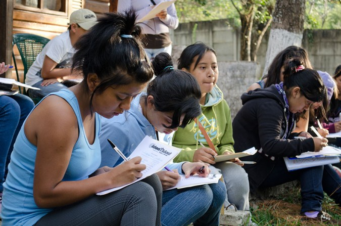 Students studying during a small group session at Campamento