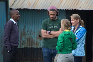 Pastor Fred (left), speaking with Clay, his sister and his mother at Hope Academy