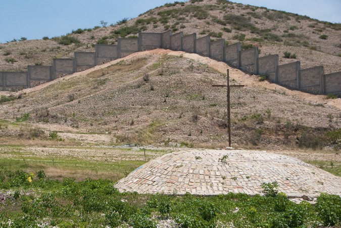 I learned that this walled area was not the gravesite. It was the hill behind it – a hill covering thousands of bodies. The entire hillside was one mass grave.