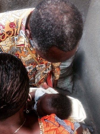 Pastor prays over a baby recently born in the prison