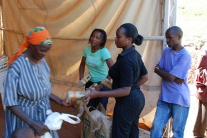 Karura's interns and volunteers pass out food to members of the community.