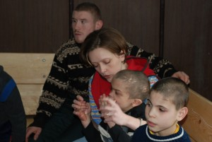 Oxana, one of the MTU staff members, working with mentally disabled orphans.
