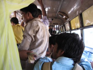On a bus in New Delhi.  I actually got a seat!  Of course, some guy had his belly resting on my shoulder the whole time, so I can't decide if I was lucky or not...