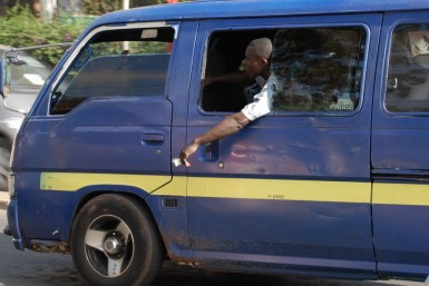 "A standard Nairobi matatu.  The dude hanging out the window is called a ""Taut."""