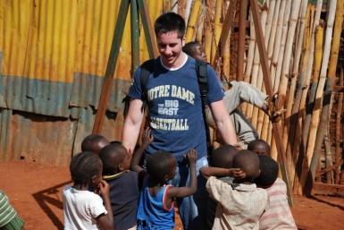 Scott being swarmed by kids in Huruma slum.