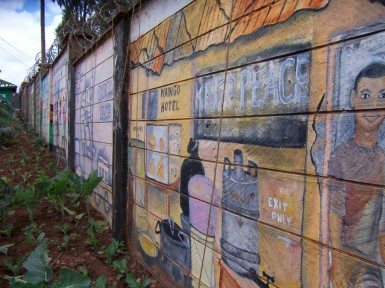 This wall in Kibera was torn down during the violence and then rebuilt.  The mural depicts the right of every person to vote in peace.