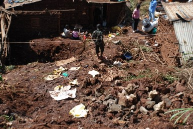 The landslide.  Walls of the crushed home are still visible in the top left of the image.