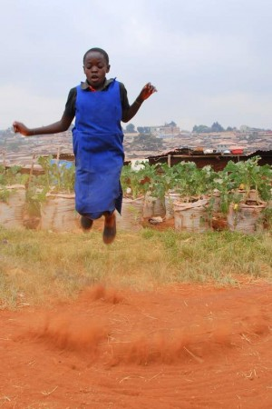 A girl jumping rope in Kibera.  Every time the rope came down, a new cloud of dust would be kicked up.