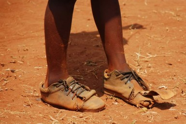 This boy, like many in Kibera, was absolutely covered in dust.  And with prices so high, new shoes will have to wait.