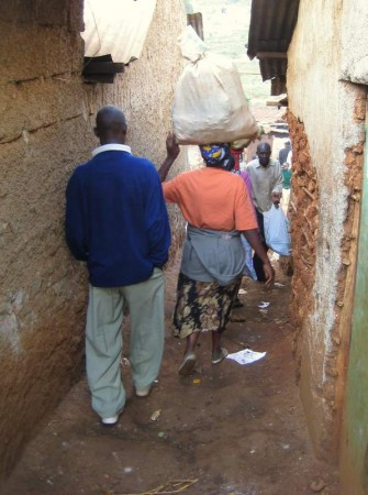 Walking from one place to the next in Kibera.