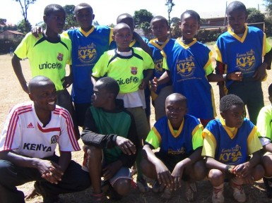 Young, at-risk, boys playing for KYSA's soccer team.