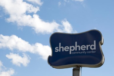 Shepherd's sign, a symbol of hope for a struggling neighborhood.