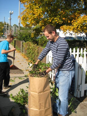 Jack Morgan and his father, Mitch, work to make the Outreach, Inc. home as welcoming on the outside as the staff inside.