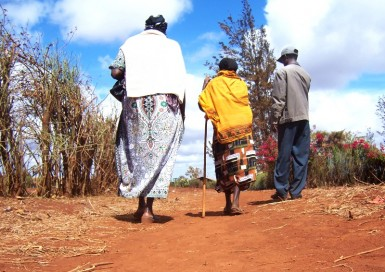 Once the feeding program in Marsabit was underway, Martha took joy in inviting strangers to come over for a meal, such as this elderly woman (center) who had approached us on the road for help.